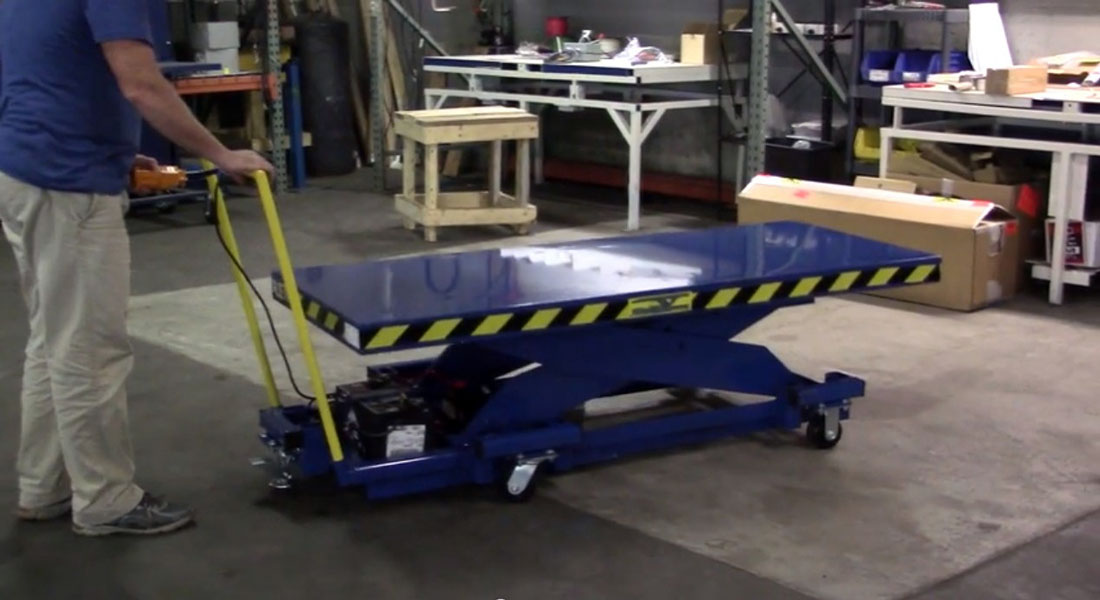 большой гидравлический подъемный стол на колесах